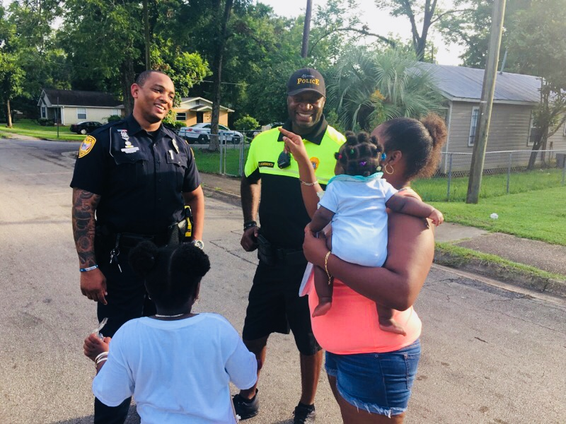 A TPD Officer interacts with members of the community