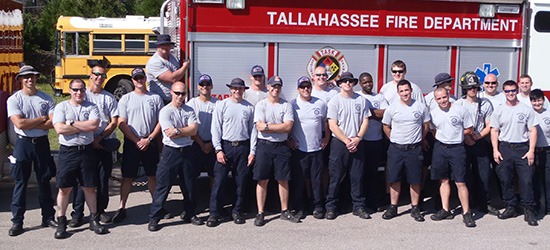The Tallahassee Fire Department lined up in front of a truck