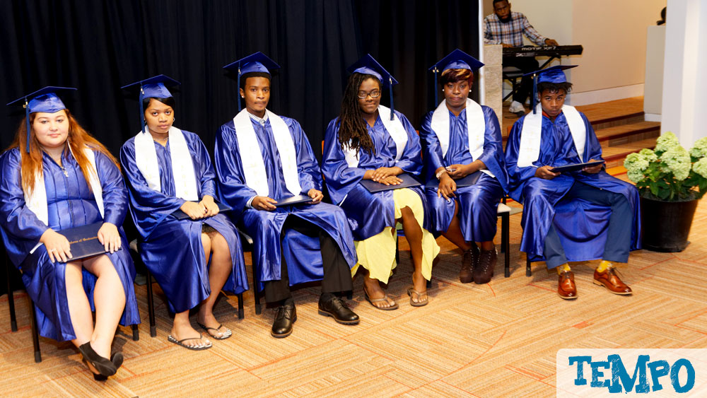The graduates sat in two rows beside the podium
