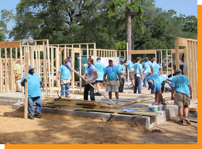 volunteers working to build a house